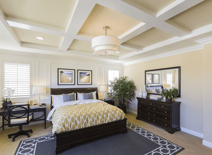 Showcasing a bedroom with ceiling, crown, and picture moulding.