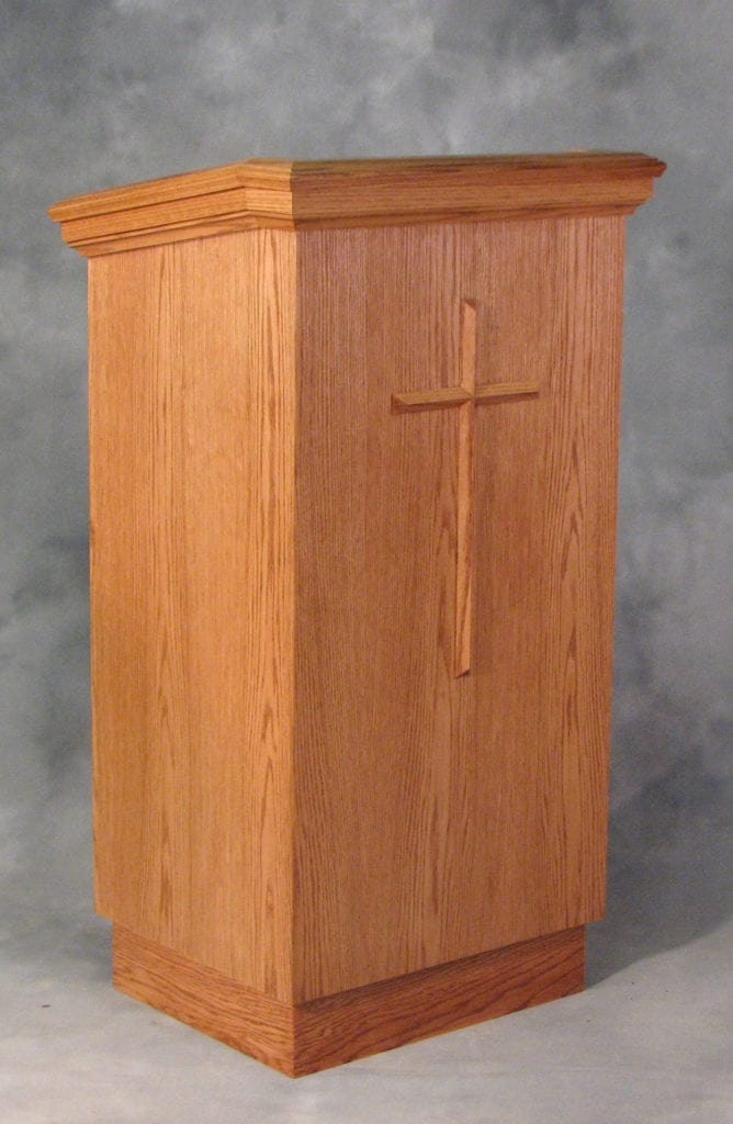 wood crafted lectern with cross woodwork