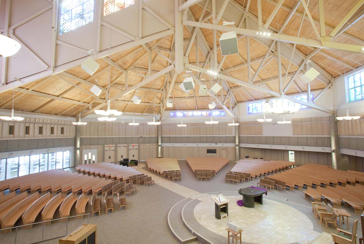 Wide view of church interior including rafters