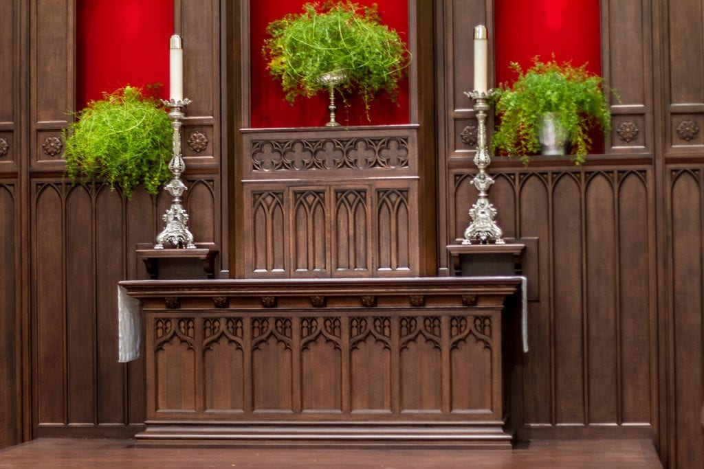 Wooden wall detail with silver candle sticks