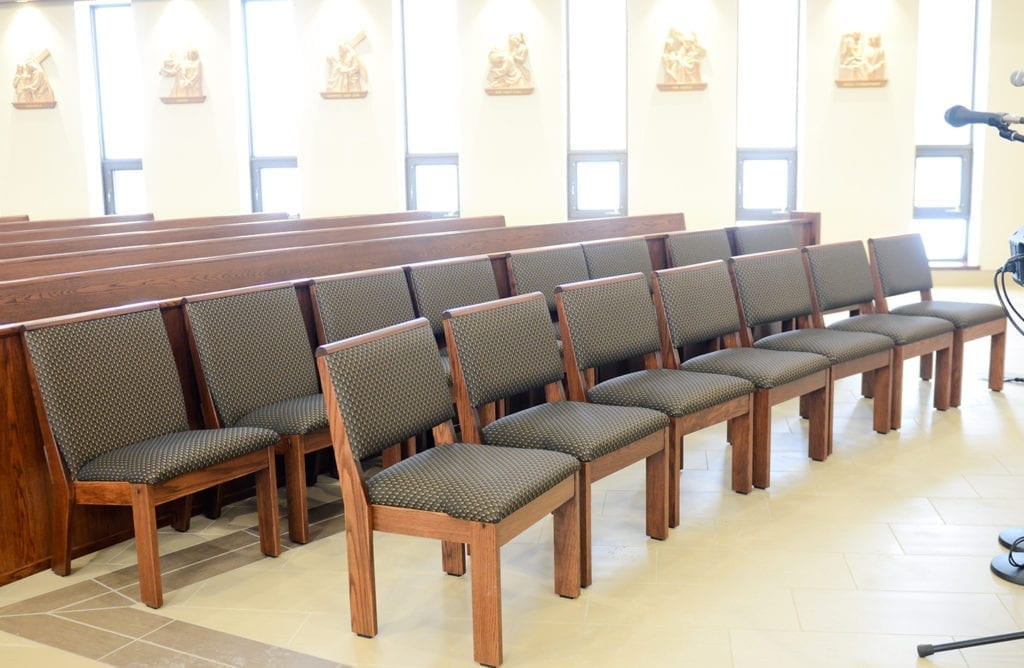 Row of chairs in front of pews