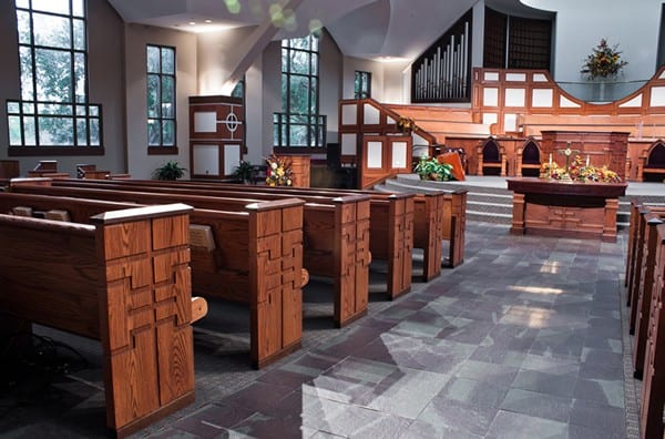 walkway showing altar table and pew ends