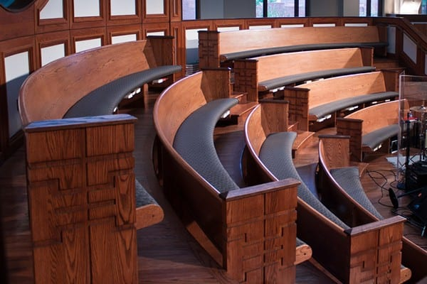 curved pew benches in an elevated design