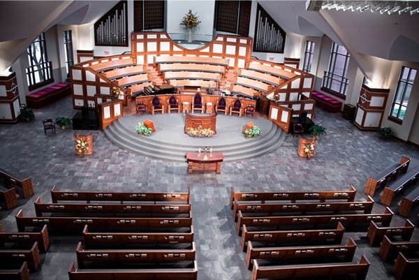 front of church from balcony with pews and stage