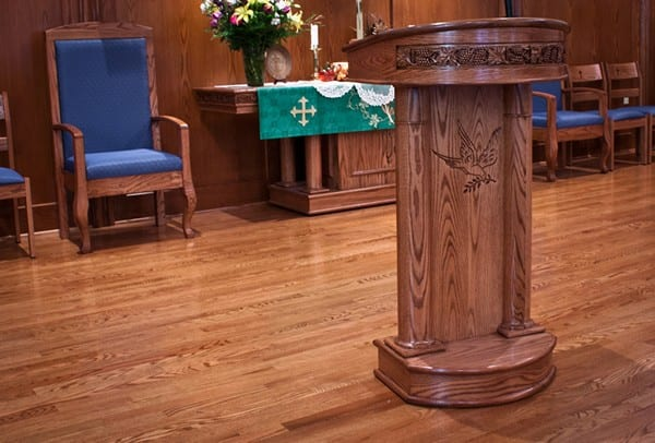 lectern with communion table in background