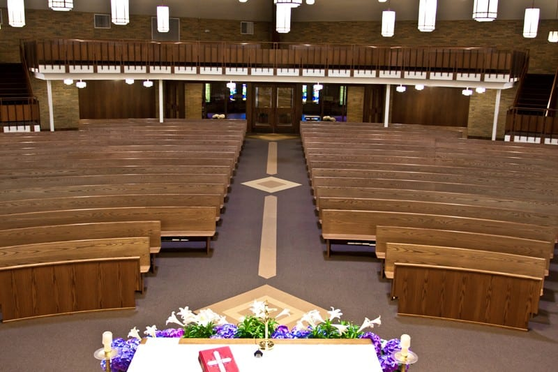 walkway with pews and bible