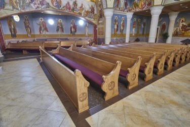 pews with maroon cushion seating
