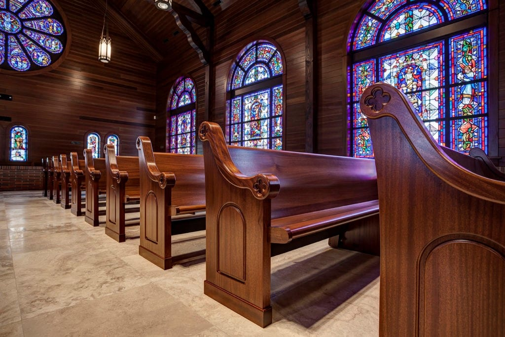 Recently disinfected, clean church pews awaiting a congregation's arrival