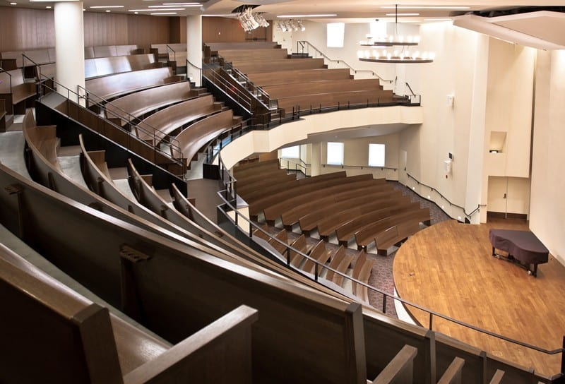 Custom radius curved pews installed in Redeemer Presbyterian Church