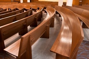 Curved wooden church pews at the Redeemer Presbyterian Church