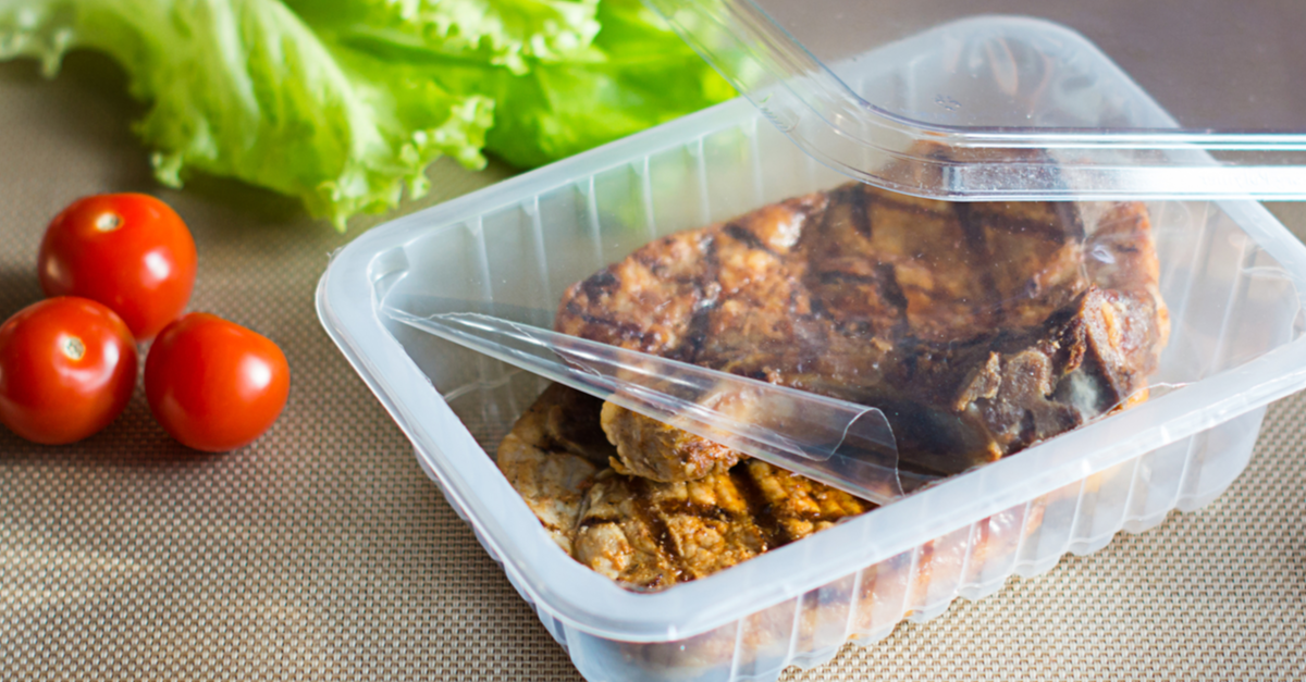 Meat in plastic container with plastic sealing