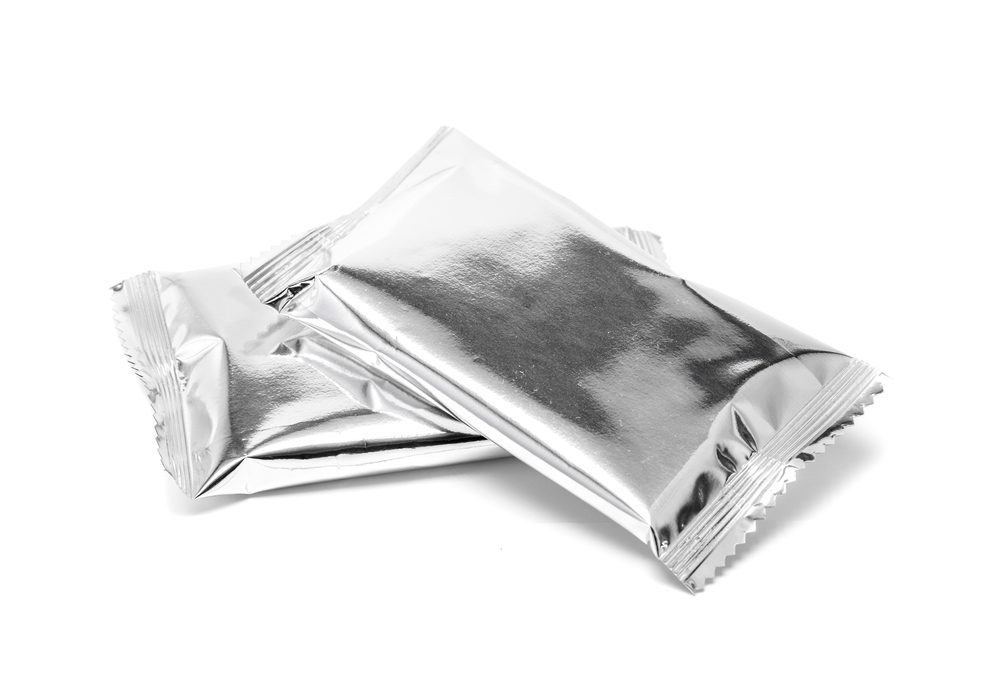 Blank foil sachet formed packaging or four-sided seal pouch on white background