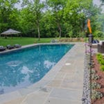 Beautiful flagstone pool deck by Dutchies