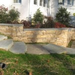 flat stack stone retaining wall with stone stairs