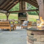 stone fireplace in an outdoor seating area