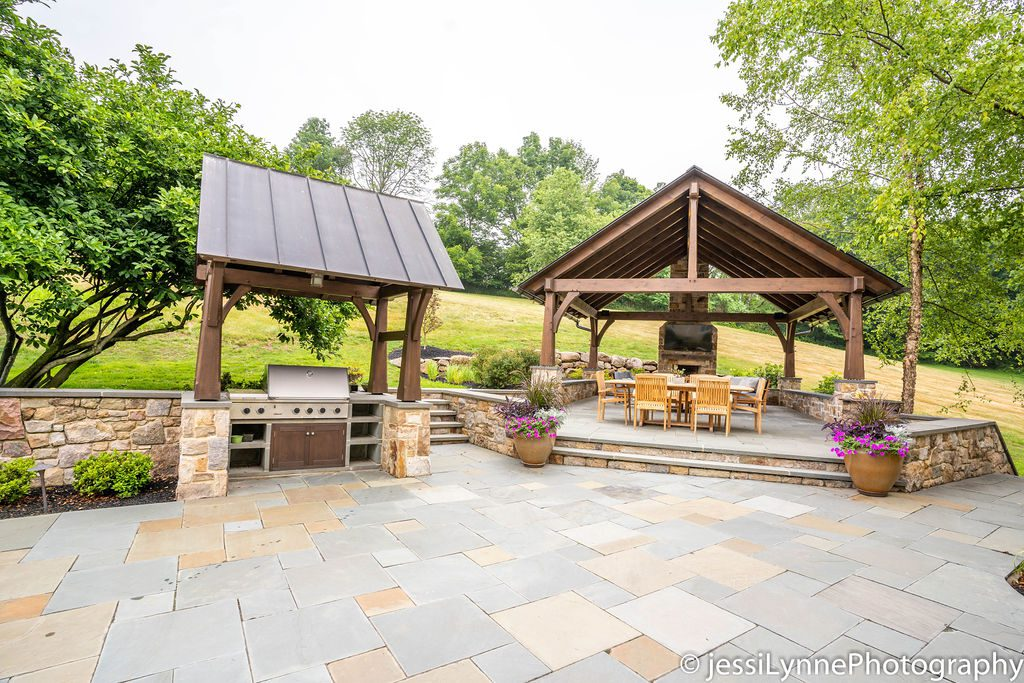 raised stone deck and outdoor grill