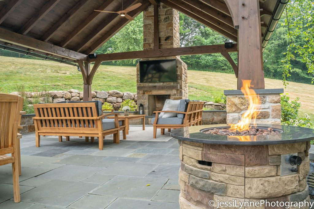 raised stone deck with fireplace