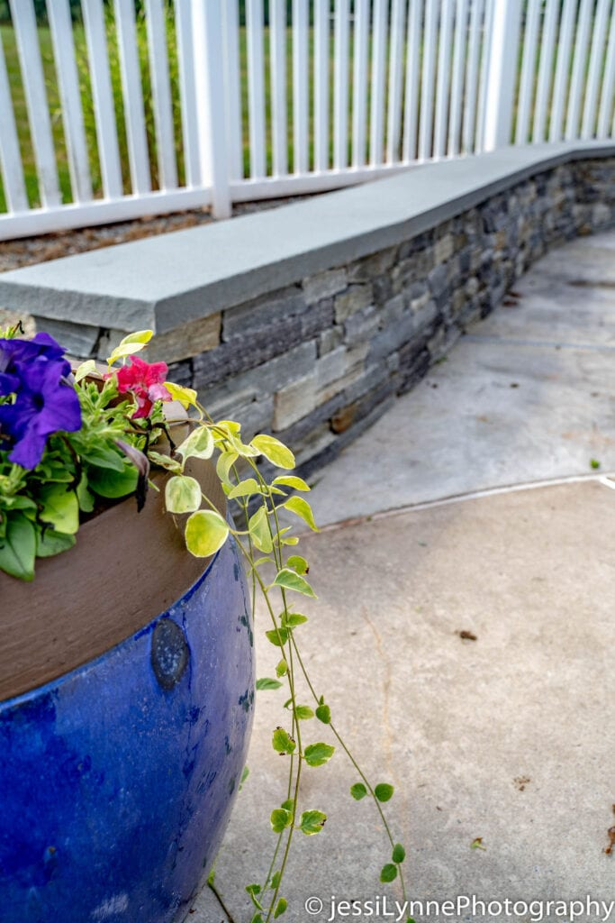 vinyl deck fence with stone wall