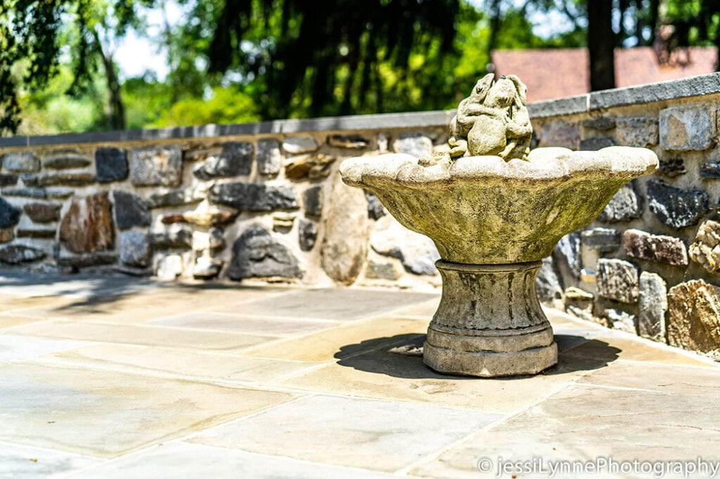 fountain by a stone wall