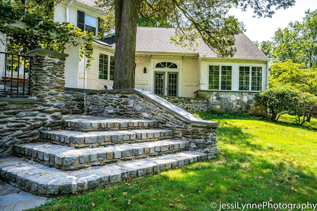 wide stone stairs outside a home