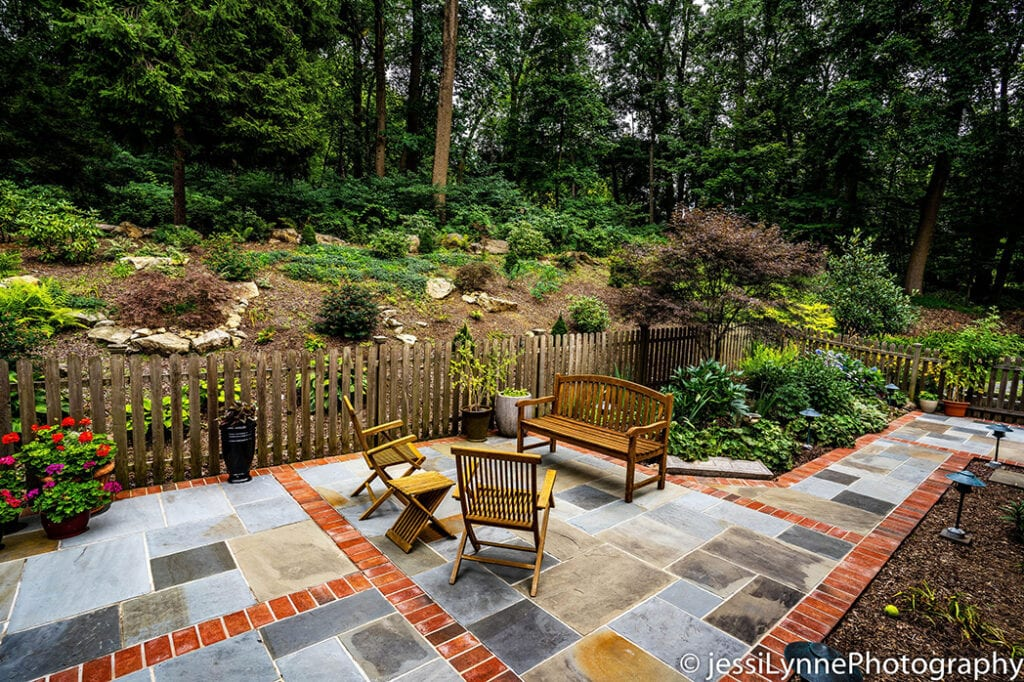 Stone patio with fence