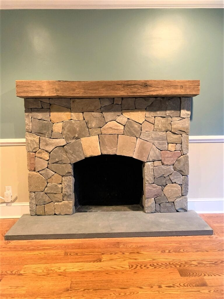Stone fireplace with wooden mantle