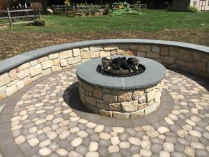 A fire pit in a secluded location provides a comfy and relaxing environment.