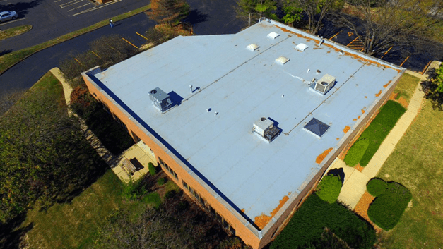 A commercial building with a white single-ply membrane roofing system