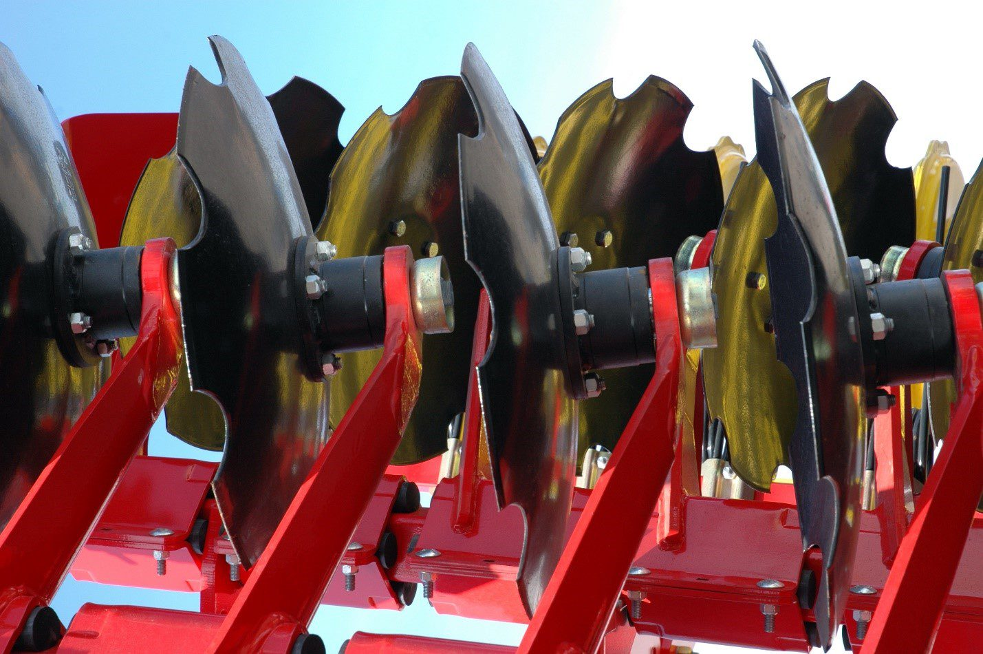 Farm equipment coated for protection with powder coating