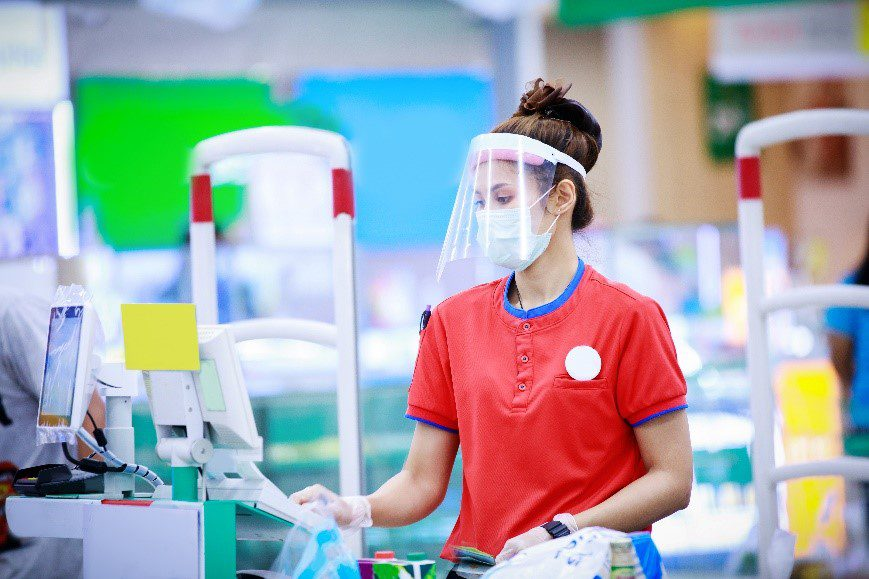 employee with a protective face mask