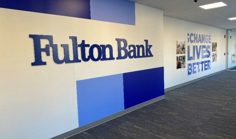 Branded photo wall by The H&H Group for Fulton Bank corporate offices