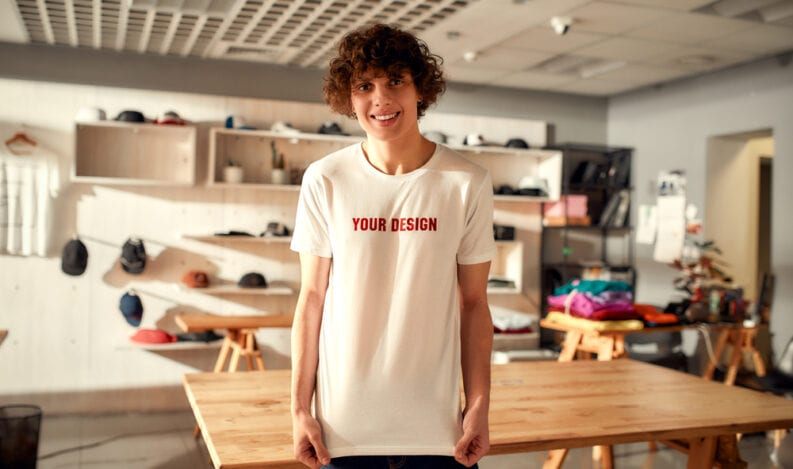 Branded apparel designer wearing customizable shirt in design studio
