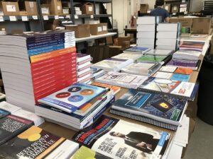A table filled with stacks of print-on-demand items.