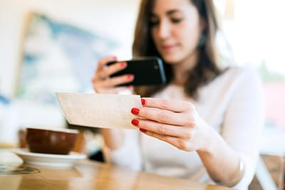 Woman depositing a check on mobile