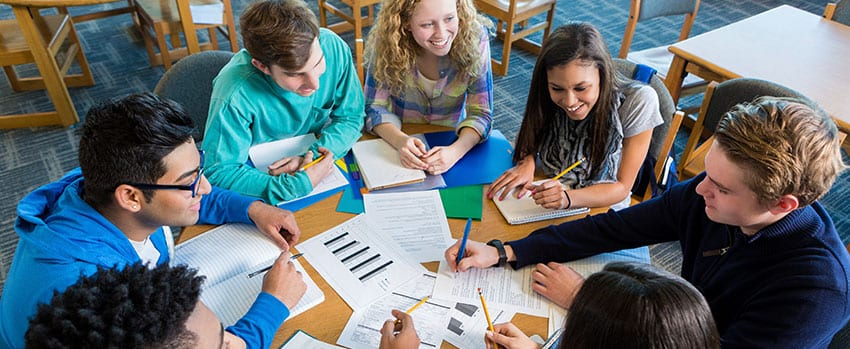 Students studying in library study space