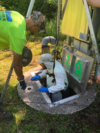 men working on septic system