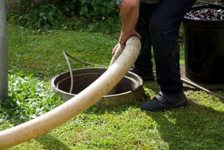 Septic professional pumping out a septic system