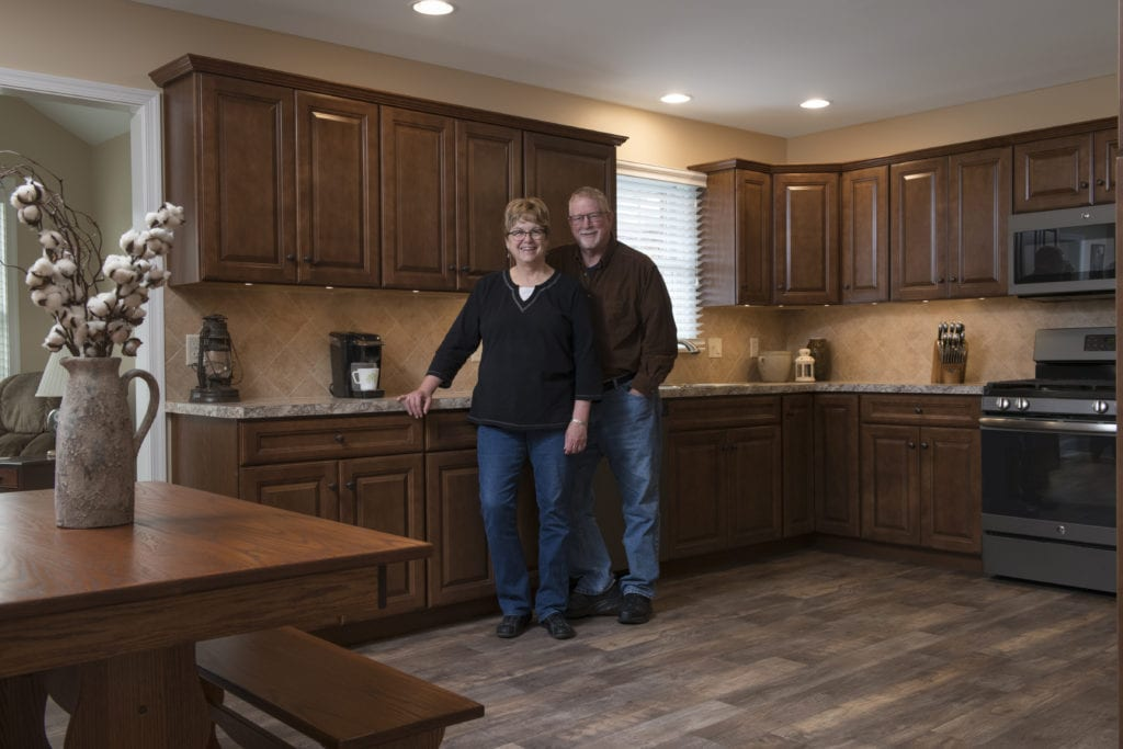 Couple in their new kitchen