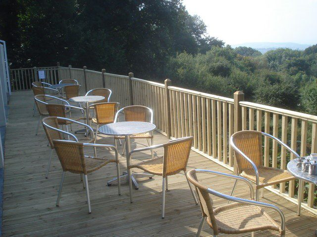 back porch patio with tables & chairs