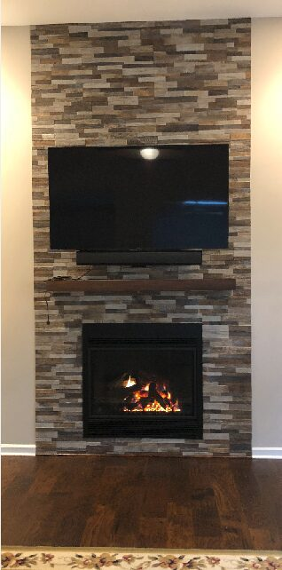 Television mounted above fireplace