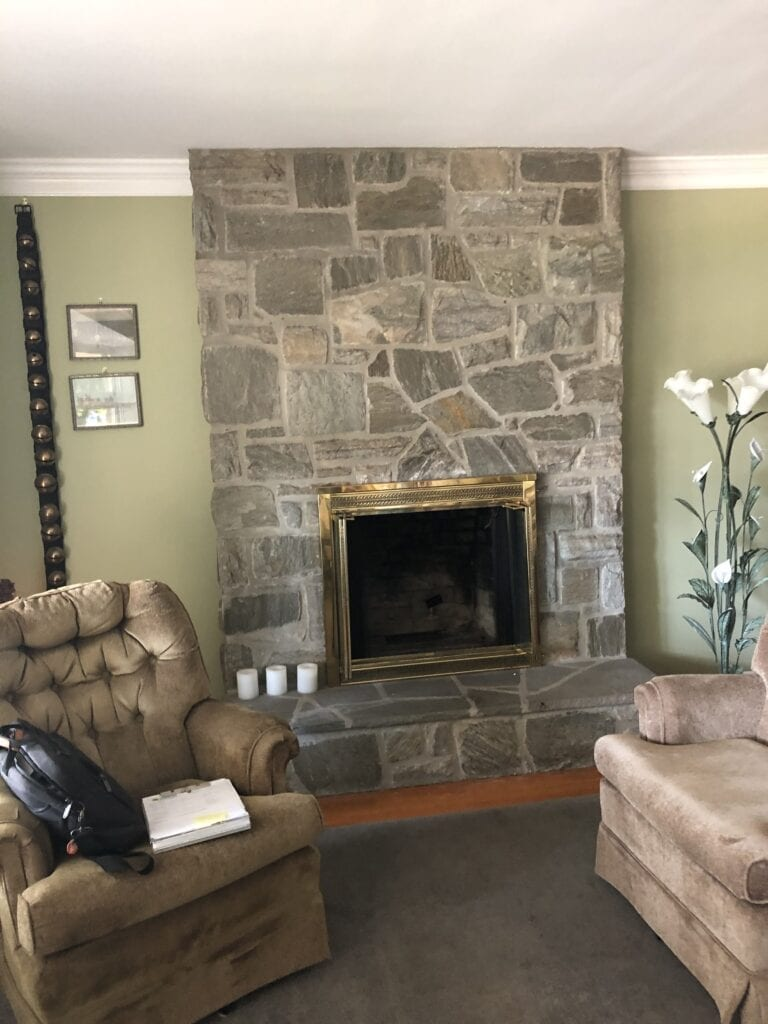 recliner in front of fireplace