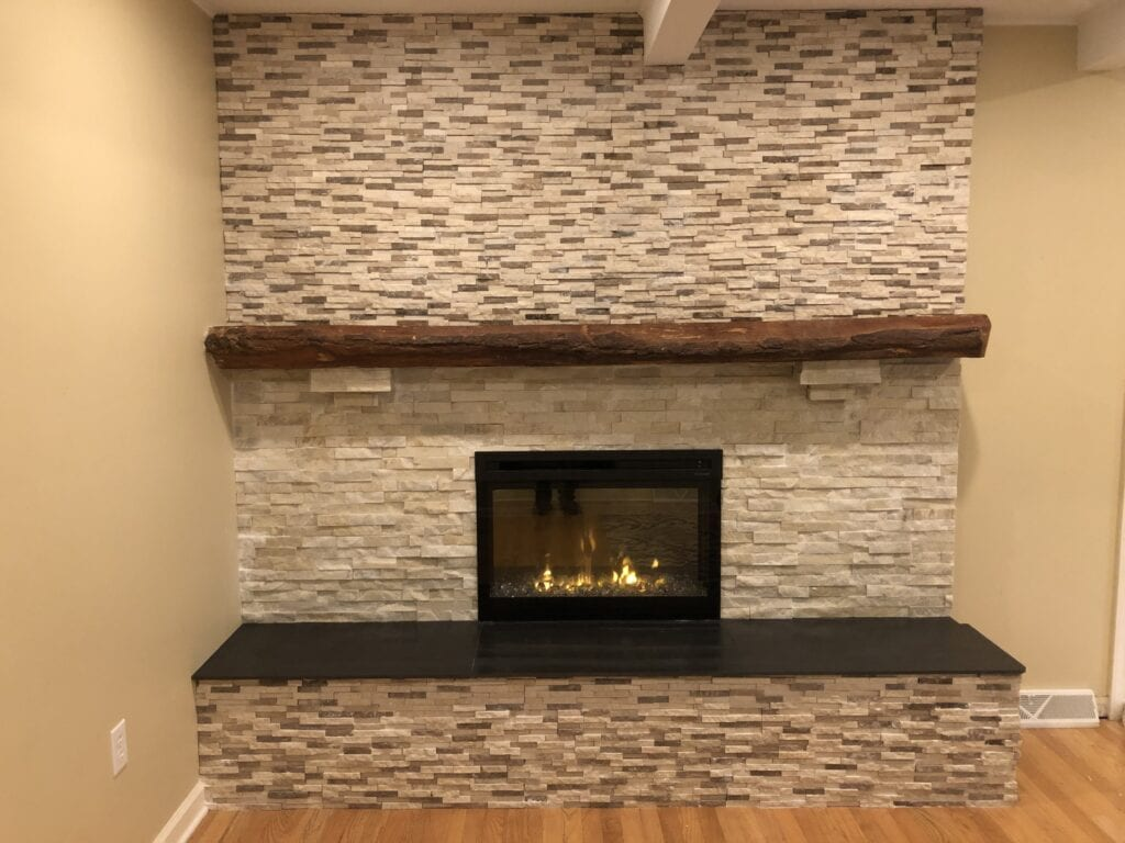 gas fireplace with stone chimney