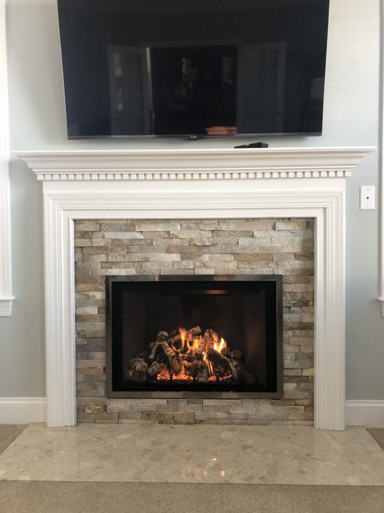 new stone fireplace with white mantle