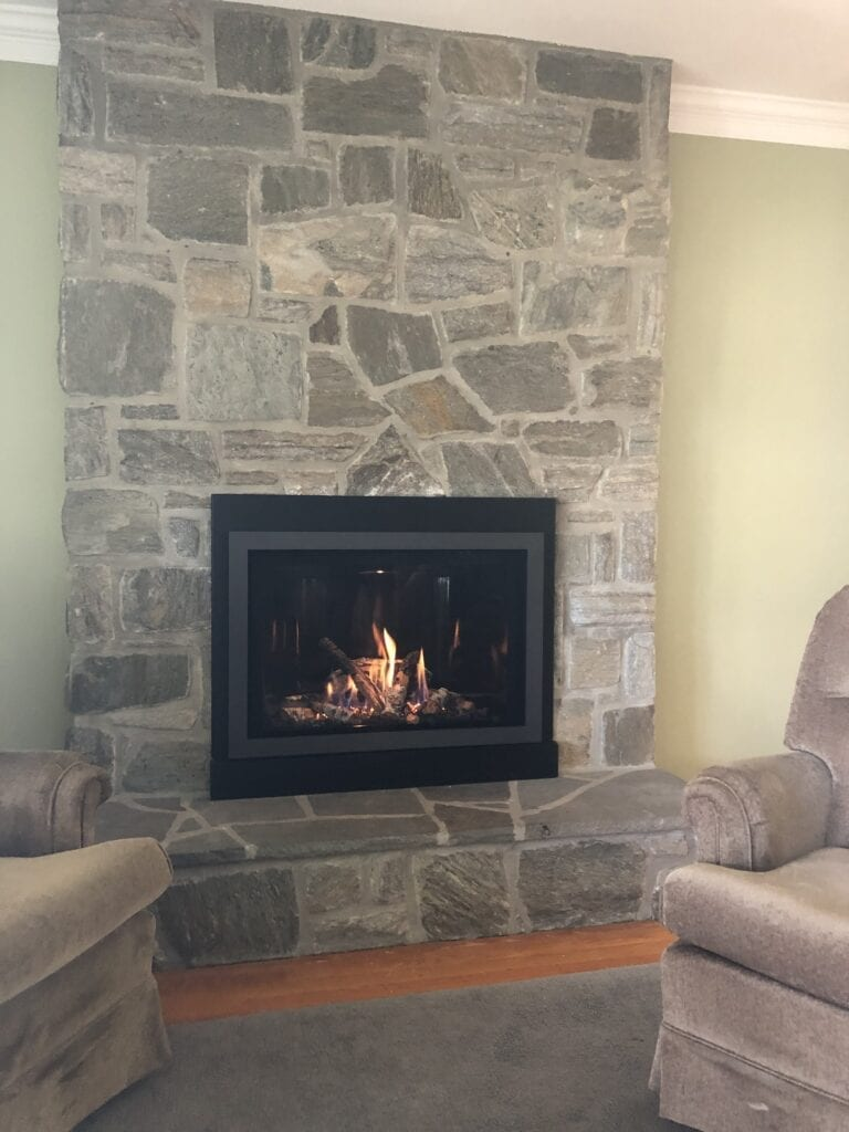recliners in front of new fireplace