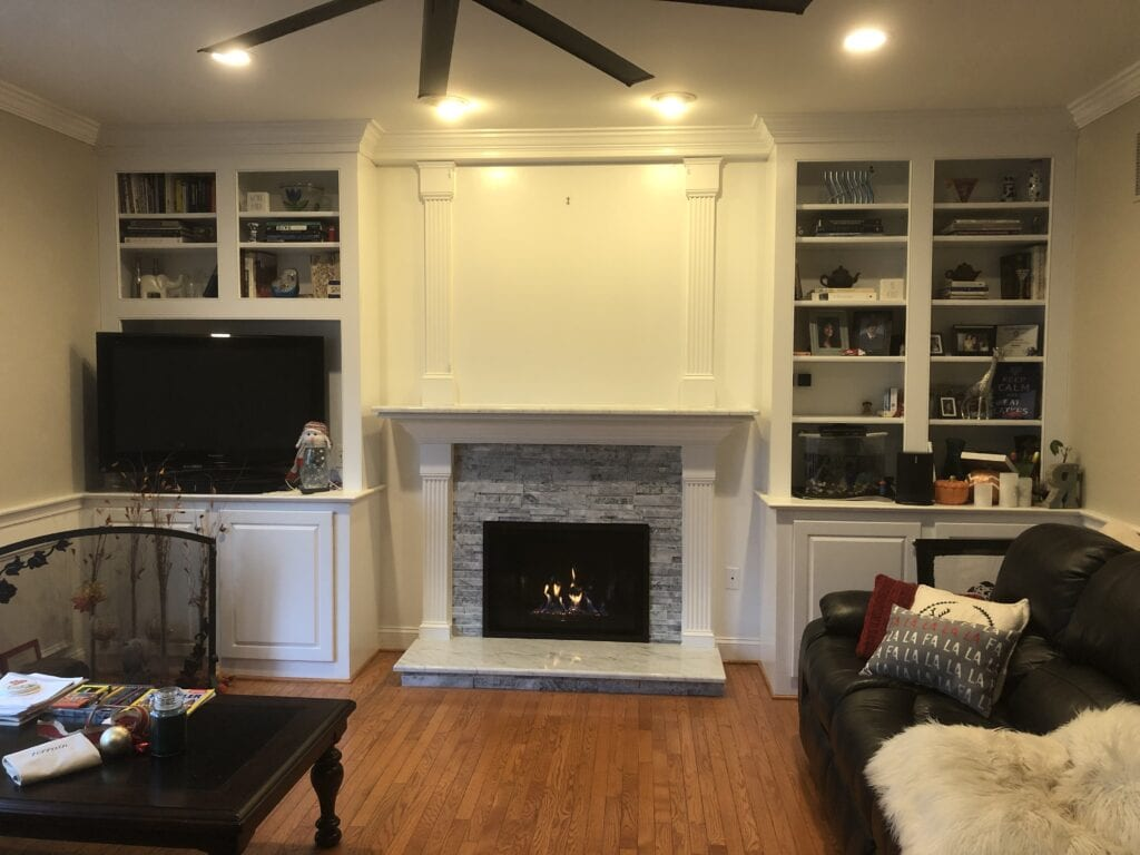 fireplace and built-in bookshelves