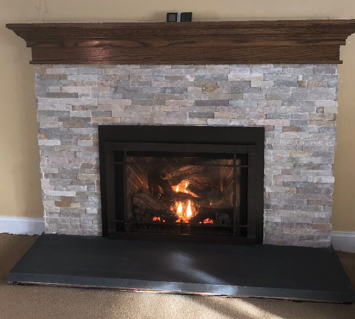 fireplace with wooden mantel