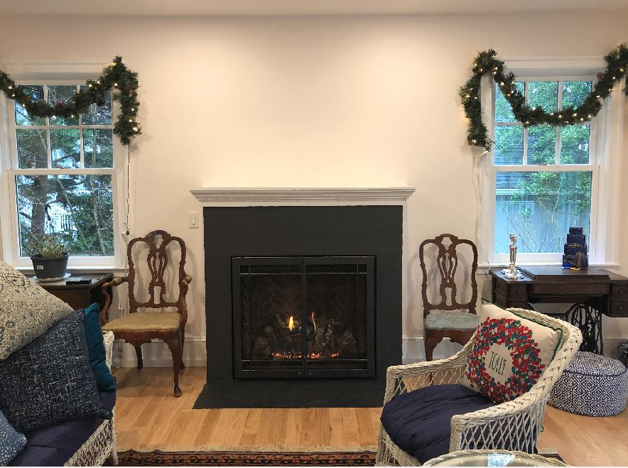 black fireplace on a white wall