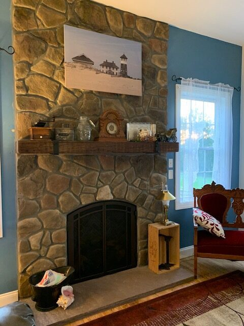 fireplace with hanging picture