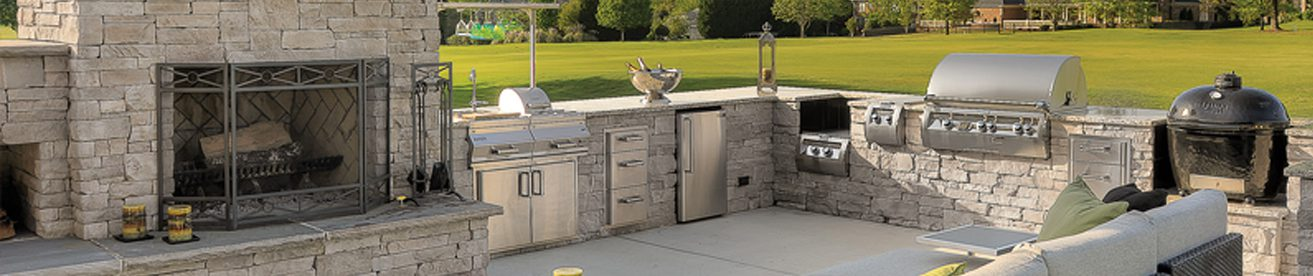 built in kitchen outdoors with stone countertops