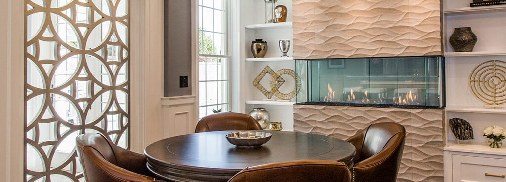gas fireplace in dining area behind table